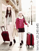 Купить «tourists girl and woman walking with baggage», фото № 29240645, снято 19 ноября 2017 г. (c) Яков Филимонов / Фотобанк Лори
