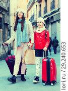 Купить «female and child girl going with baggage», фото № 29240653, снято 19 ноября 2017 г. (c) Яков Филимонов / Фотобанк Лори