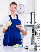 Купить «Female office cleaner is talking while cleaning the cabinet», фото № 29240893, снято 9 июня 2017 г. (c) Яков Филимонов / Фотобанк Лори