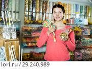 Купить «girl buying candies at shop», фото № 29240989, снято 22 марта 2017 г. (c) Яков Филимонов / Фотобанк Лори