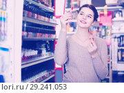 Купить «female customer looking for lipstick in cosmetics shop», фото № 29241053, снято 21 февраля 2017 г. (c) Яков Филимонов / Фотобанк Лори