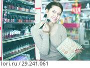 Купить «young woman customer deciding on compact powder in shop», фото № 29241061, снято 21 февраля 2017 г. (c) Яков Филимонов / Фотобанк Лори