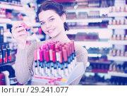 Купить «Seller demonstrating assortment», фото № 29241077, снято 21 февраля 2017 г. (c) Яков Филимонов / Фотобанк Лори