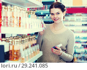 Купить «Young female client is searching for strong perfume», фото № 29241085, снято 21 февраля 2017 г. (c) Яков Филимонов / Фотобанк Лори