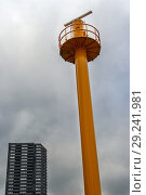 Купить «Rotterdam, Netherlands. Freshly painted radar tower inside Port of Rotterdam Harbor, scanning for marine traffic on Nieuwe Maas River.», фото № 29241981, снято 4 октября 2018 г. (c) age Fotostock / Фотобанк Лори