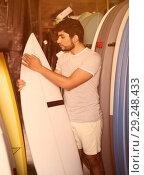 Купить «male surfer holding professional surfboard», фото № 29248433, снято 22 августа 2017 г. (c) Яков Филимонов / Фотобанк Лори