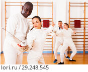 Купить «fencer practicing movements with african american trainer», фото № 29248545, снято 11 июля 2018 г. (c) Яков Филимонов / Фотобанк Лори