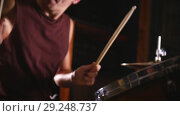 Купить «Drummer plays music on wet drums in studio in a garage. Snare close up», видеоролик № 29248737, снято 8 июля 2020 г. (c) Константин Шишкин / Фотобанк Лори