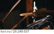 Купить «Drummer playing in studio in a garage. hi-hat.», видеоролик № 29249037, снято 8 июля 2020 г. (c) Константин Шишкин / Фотобанк Лори