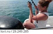 Купить «Женщина на лодке во время морской рыбалки», видеоролик № 29249285, снято 26 августа 2018 г. (c) Кекяляйнен Андрей / Фотобанк Лори