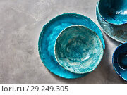 Porcelain blue bowls and plates on a gray table . Colorful ceramic vintage handmade dishes. Flat lay. Стоковое фото, фотограф Ярослав Данильченко / Фотобанк Лори