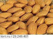 Купить «Фон из миндальных орехов», фото № 29249401, снято 17 октября 2018 г. (c) Елена Коромыслова / Фотобанк Лори