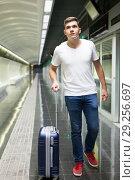 Купить «Man with luggage bag in subway station», фото № 29256697, снято 24 августа 2018 г. (c) Яков Филимонов / Фотобанк Лори