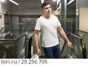 Купить «Man on subway station escalator», фото № 29256705, снято 24 августа 2018 г. (c) Яков Филимонов / Фотобанк Лори