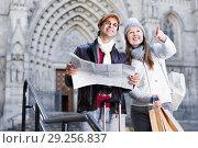 Купить «Man and woman with map and package looking attraction outdoors», фото № 29256837, снято 18 ноября 2017 г. (c) Яков Филимонов / Фотобанк Лори