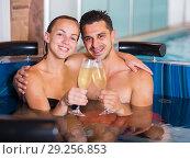 Купить «Romantic couple is relaxing with glasses of vine», фото № 29256853, снято 18 июля 2017 г. (c) Яков Филимонов / Фотобанк Лори