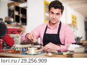 Купить «Craftsman in uniform working in carpentry», фото № 29256909, снято 8 апреля 2017 г. (c) Яков Филимонов / Фотобанк Лори