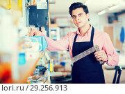 Купить «Joiner looking for necessary tools», фото № 29256913, снято 8 апреля 2017 г. (c) Яков Филимонов / Фотобанк Лори