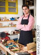 Купить «Carpenter working on manual lathe», фото № 29256917, снято 8 апреля 2017 г. (c) Яков Филимонов / Фотобанк Лори