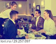 Купить «friendly waitress bringing delicious salads to smiling people at restaurant», фото № 29257097, снято 7 ноября 2017 г. (c) Яков Филимонов / Фотобанк Лори