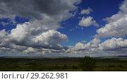Купить «Summer landscape with cloudy sky, timelapse», видеоролик № 29262981, снято 5 октября 2018 г. (c) Михаил Коханчиков / Фотобанк Лори