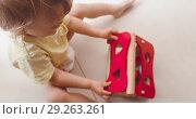 Купить «Cute little baby boy playing with small wooden house», видеоролик № 29263261, снято 18 июня 2018 г. (c) Ekaterina Demidova / Фотобанк Лори