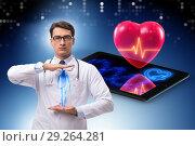 Купить «Telemedicine concept with remote monitoring of heart condition», фото № 29264281, снято 17 декабря 2018 г. (c) Elnur / Фотобанк Лори
