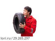 Купить «Young garage worker with tyre isolated on white», фото № 29265297, снято 21 июля 2018 г. (c) Elnur / Фотобанк Лори