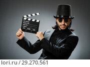 Купить «Vintage concept with man wearing black top hat», фото № 29270561, снято 1 июня 2015 г. (c) Elnur / Фотобанк Лори