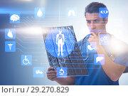 Купить «Doctor looking at x-ray image in telehealth concept», фото № 29270829, снято 26 марта 2019 г. (c) Elnur / Фотобанк Лори