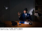 Купить «Detective sitting in dark room in vintage concept», фото № 29271001, снято 13 июля 2017 г. (c) Elnur / Фотобанк Лори