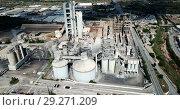 Купить «Aerial view of cement production plant», видеоролик № 29271209, снято 26 августа 2018 г. (c) Яков Филимонов / Фотобанк Лори