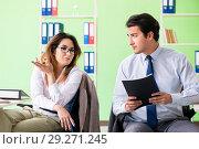 Купить «Two colleagues working in the office», фото № 29271245, снято 11 июня 2018 г. (c) Elnur / Фотобанк Лори