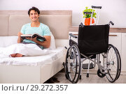 Купить «Young handsome disabled man recovering at home», фото № 29272357, снято 28 июня 2018 г. (c) Elnur / Фотобанк Лори