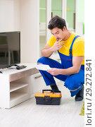 Купить «Male professional serviceman repairing tv at home», фото № 29272841, снято 8 мая 2018 г. (c) Elnur / Фотобанк Лори