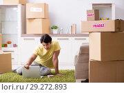 Купить «Man moving house and relocating with fragile items», фото № 29272893, снято 4 июля 2018 г. (c) Elnur / Фотобанк Лори