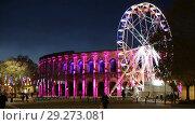 Купить «Spinning ferris wheel near illuminated Arena of Nimes, France», видеоролик № 29273081, снято 1 декабря 2017 г. (c) Яков Филимонов / Фотобанк Лори