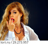 Купить «Woman eating berry. Pin up girl wearing unbuttoned blouse and bra.», фото № 29273957, снято 21 октября 2018 г. (c) Gennadiy Poznyakov / Фотобанк Лори