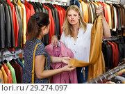 Купить «professional shopping assistant demonstrating female customer leather jackets in store», фото № 29274097, снято 5 сентября 2018 г. (c) Яков Филимонов / Фотобанк Лори