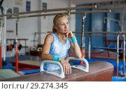 Купить «Woman posing near gymnastic equipment», фото № 29274345, снято 18 июля 2018 г. (c) Яков Филимонов / Фотобанк Лори