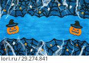 Купить «Halloween background.Spider web,spiders and smiling jack decorations - symbols of Halloween on the dark blue background», фото № 29274841, снято 8 октября 2018 г. (c) Зезелина Марина / Фотобанк Лори