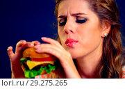 Купить «Woman bite fast food. Girl desire delicious hamburger.», фото № 29275265, снято 20 марта 2019 г. (c) Gennadiy Poznyakov / Фотобанк Лори