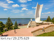 """Russia, Samara, May 2016: celebration of graduates of the city's schools on the embankment of the Volga River near the """"Boat"""" complex. Spring sunny day. The text in Russian: the last call. Редакционное фото, фотограф Акиньшин Владимир / Фотобанк Лори"""