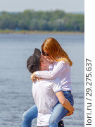 Купить «Russia, Samara, May 2016: young people embrace and kiss after the holiday, Last bell at school, on the Volga River Embankment on a spring sunny day.», фото № 29275637, снято 25 мая 2016 г. (c) Акиньшин Владимир / Фотобанк Лори