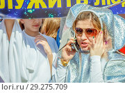 Купить «Russia, Samara, April 12, 2016: a young beautiful girl dressed with space theme, on holiday, Cosmonautics Day, in the square with a space rocket, on a spring sunny day.», фото № 29275709, снято 12 апреля 2016 г. (c) Акиньшин Владимир / Фотобанк Лори