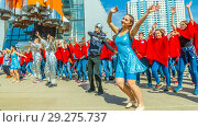 Купить «Russia, Samara, April 12, 2016: young people dressed in elegant costumes dance for the holiday, Cosmonautics Day, in the square with a space rocket, on a spring sunny day.», фото № 29275737, снято 12 апреля 2016 г. (c) Акиньшин Владимир / Фотобанк Лори