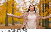 Купить «happy young woman in autumn park», видеоролик № 29276745, снято 18 октября 2018 г. (c) Syda Productions / Фотобанк Лори