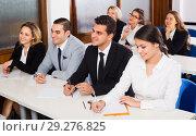 Купить «Professor and professionals at courses», фото № 29276825, снято 23 октября 2018 г. (c) Яков Филимонов / Фотобанк Лори