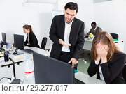 Купить «Unhappy woman manager working at laptop and angry man boss pointinting to misses in work», фото № 29277017, снято 24 марта 2018 г. (c) Яков Филимонов / Фотобанк Лори
