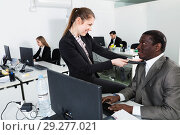 Купить «Sexual harassment between two colleagues and flirting in office», фото № 29277021, снято 24 марта 2018 г. (c) Яков Филимонов / Фотобанк Лори